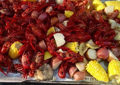 Crawfish boil - crawfish, fresh local corn on the cob, and red potatoes. Simons food catering.