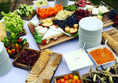 Catered appetizers include hors d'oeuvres, crackers and assorted vegetables and cheeses. Simons food catering.